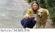Young girl taking selfie with her dog 4k. Стоковое видео, агентство Wavebreak Media / Фотобанк Лори