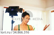 Female video blogger recording video vlog while exercising at home 4k. Стоковое видео, агентство Wavebreak Media / Фотобанк Лори