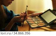 Woman using makeup brush at home 4k. Стоковое видео, агентство Wavebreak Media / Фотобанк Лори