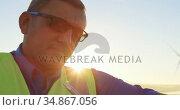 Engineer writing on clipboard in the wind farm 4k. Стоковое видео, агентство Wavebreak Media / Фотобанк Лори