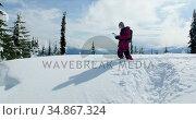 Woman with map walking in the snow 4k. Стоковое видео, агентство Wavebreak Media / Фотобанк Лори