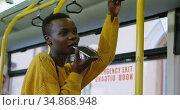 Woman talking on mobile phone while travelling in bus 4k. Стоковое видео, агентство Wavebreak Media / Фотобанк Лори