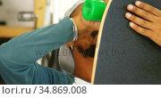 Man making skateboard 4k. Стоковое видео, агентство Wavebreak Media / Фотобанк Лори
