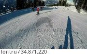 Skiers skiing down a snowy hill 4k. Стоковое видео, агентство Wavebreak Media / Фотобанк Лори