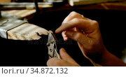 Jewelry designer making jewelry in workshop 4k. Стоковое видео, агентство Wavebreak Media / Фотобанк Лори