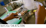 Chef putting butter to pan in kitchen 4k. Стоковое видео, агентство Wavebreak Media / Фотобанк Лори