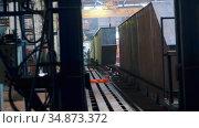 Industrial production plant and a crane hook hanging under the ceiling. Стоковое видео, видеограф Константин Шишкин / Фотобанк Лори