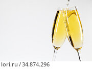 Champagne pouring in two glasses. Стоковое фото, фотограф Иван Михайлов / Фотобанк Лори