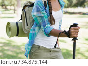 Young woman on a hike in the countryside. Стоковое фото, агентство Wavebreak Media / Фотобанк Лори