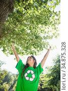 Environmental activist enjoying the sunshine in the park. Стоковое фото, агентство Wavebreak Media / Фотобанк Лори