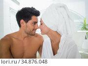 Boyfriend and girlfriend facing each other in towels . Стоковое фото, агентство Wavebreak Media / Фотобанк Лори
