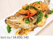 Deep fried sweet and sour spicy sauce grouper fish. Стоковое фото, фотограф Vichaya Kiatying-Angsulee / easy Fotostock / Фотобанк Лори