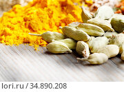 Assorted spices and dry herbs on wooden background. Стоковое фото, фотограф Olena Mykhaylova / easy Fotostock / Фотобанк Лори
