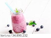 Mason jar with Blueberry shake on white table. Smoothie concept. Стоковое фото, фотограф Olena Mykhaylova / easy Fotostock / Фотобанк Лори
