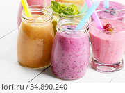 Assorted fruit and vegetable shakes on white table. Smoothie concept. Стоковое фото, фотограф Olena Mykhaylova / easy Fotostock / Фотобанк Лори