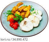 Hake fish with parsley, pickled tomatoes and potatoes. Стоковое фото, фотограф Яков Филимонов / Фотобанк Лори