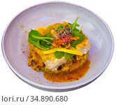 Codfish baked with curry and served with quinoa and greens. Стоковое фото, фотограф Яков Филимонов / Фотобанк Лори