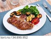 Grilled veal chop with vegetables and greens. Стоковое фото, фотограф Яков Филимонов / Фотобанк Лори