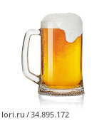 Mug of beer with froth foam isolated on a white background. Стоковое фото, фотограф Александр Лычагин / Фотобанк Лори