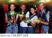 friends holding colored laser guns during laser tag game. Стоковое фото, фотограф Яков Филимонов / Фотобанк Лори