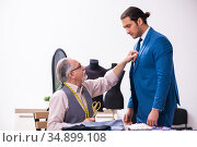 Young businessman visiting old male tailor. Стоковое фото, фотограф Elnur / Фотобанк Лори