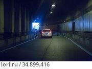 Cars leaving tunnel in downtown. Стоковое фото, фотограф Юрий Бизгаймер / Фотобанк Лори
