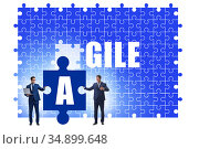 Agile concept with businessman putting jigsaw puzzle together. Стоковое фото, фотограф Elnur / Фотобанк Лори