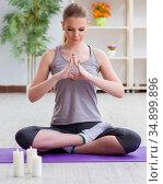 Young woman in lotus pose meditating in spa gym. Стоковое фото, фотограф Elnur / Фотобанк Лори