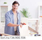 Young man in woodworking hobby concept. Стоковое фото, фотограф Elnur / Фотобанк Лори