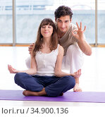 Personal coach helping during yoga session. Стоковое фото, фотограф Elnur / Фотобанк Лори