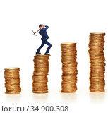 Cryptocurrency concept with businessman mining money. Стоковое фото, фотограф Elnur / Фотобанк Лори