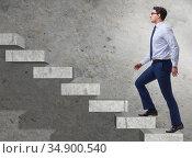 Young businessman climbing career ladder. Стоковое фото, фотограф Elnur / Фотобанк Лори