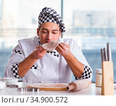 Young man cooking cookies in kitchen. Стоковое фото, фотограф Elnur / Фотобанк Лори