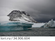 Iceberg off the coast of Franz Jozef Land, Arctic Russia. August 2017. Стоковое фото, фотограф Sergey  Gorshkov / Nature Picture Library / Фотобанк Лори