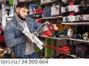 Man chooses circular saw in tool store. Стоковое фото, фотограф Яков Филимонов / Фотобанк Лори