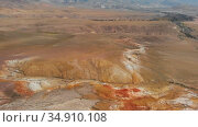 Aerial video of the textured yellow and red mountains resembling the surface of Mars. Стоковое видео, видеограф Jan Jack Russo Media / Фотобанк Лори