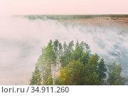 Aerial View. Spring Dry Grass Burns During Drought Hot Weather. Bush... Стоковое фото, фотограф Ryhor Bruyeu / easy Fotostock / Фотобанк Лори