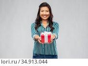 happy asian woman with birthday present. Стоковое фото, фотограф Syda Productions / Фотобанк Лори