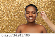 face of african woman and hand with make up brush. Стоковое фото, фотограф Syda Productions / Фотобанк Лори