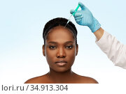 african woman and hand in glove with syringe. Стоковое фото, фотограф Syda Productions / Фотобанк Лори
