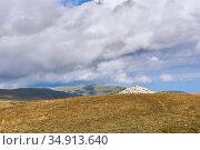 Stone cairn mound in the high-mountainous steppe. Стоковое фото, фотограф Евгений Харитонов / Фотобанк Лори
