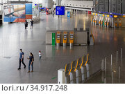 Germany, Frankfurt am Main - Hardly any operation in Terminal 1 (departures) at Frankfurt Airport due to the corona crisis. Редакционное фото, агентство Caro Photoagency / Фотобанк Лори