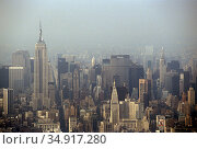 USA, New York City - The skyline of Manhattan, view from the World Trade Center, left the Empire State Building. Редакционное фото, агентство Caro Photoagency / Фотобанк Лори