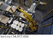 Berlin, Germany, Palletizing system in a paint factory. Редакционное фото, агентство Caro Photoagency / Фотобанк Лори
