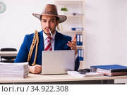Young businessman cowboy working in the office. Стоковое фото, фотограф Elnur / Фотобанк Лори