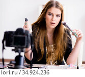 Beauty blogger filing video for her blog or vlog. Стоковое фото, фотограф Elnur / Фотобанк Лори