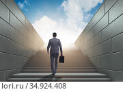 Businessman climbing up challenging career ladder in business co. Стоковое фото, фотограф Elnur / Фотобанк Лори