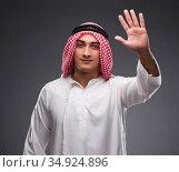 Arab businessman on gray background. Стоковое фото, фотограф Elnur / Фотобанк Лори