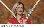 Feisty blonde woman standing with her swords crosswise. Стоковое фото, фотограф Константин Шишкин / Фотобанк Лори