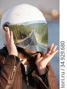 Long road reflection in mirrored tinted visor of helmet, portrait of unrecognizable European woman motorcyclist. Стоковое фото, фотограф Кекяляйнен Андрей / Фотобанк Лори